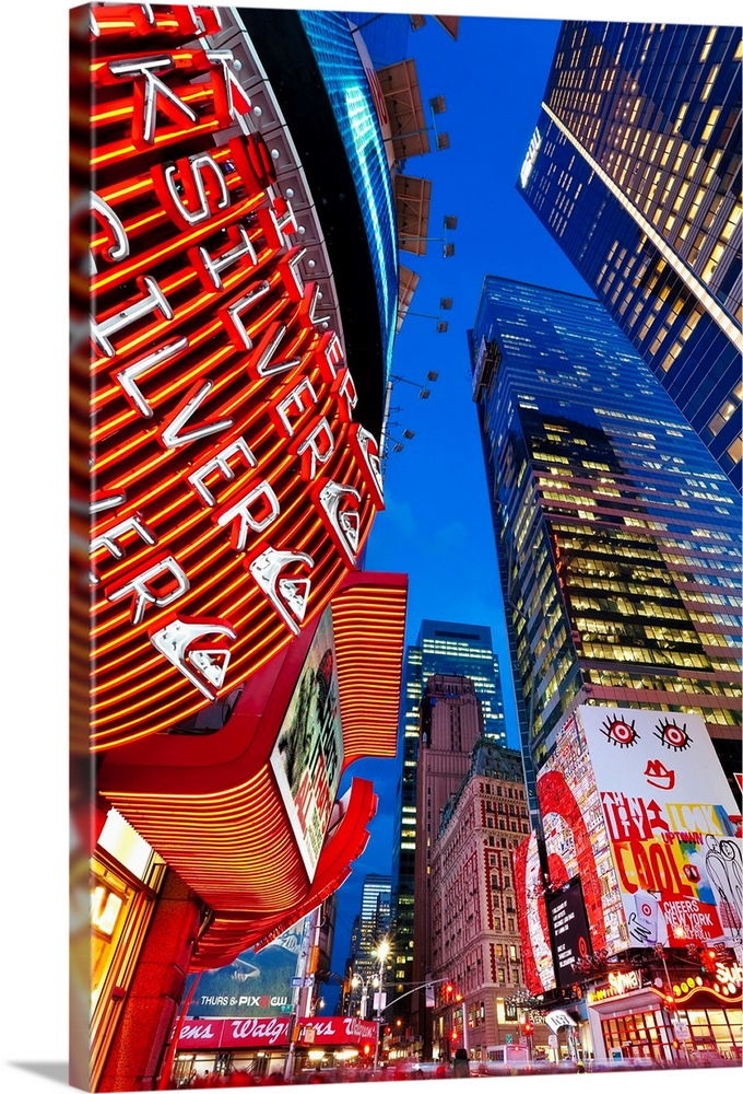 Large Solid-Faced Canvas Print Wall Art Print 20 x 30 entitled New York City, Manhattan, Times Square, Neon lights of 42nd... Solid-Faced Canvas Print entitled New York City, Manhattan, Times Square, Neon lights of 42nd Street.  USA, New York City, Manhattan, Times Square, Neon lights of 42nd Street.  Multiple sizes available.  Primary colors within this image include Dark Red, Dark Blue, Light Yellow, White.  Made in USA.  Satisfaction guaranteed.  Archival-quality UV-resistant inks.  Featuring a proprietary design, our canvases produce the tightest corners without any bubbles, ripples, or bumps and will not warp or sag over time.  Canvas is handcrafted and made-to-order in the United States using high quality artist-grade canvas.