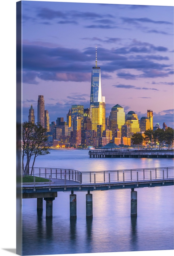 Large Solid-Faced Canvas Print Wall Art Print 24 x 36 entitled New York, Manhattan, Freedom Tower across Hudson River Solid-Faced Canvas Print entitled New York, Manhattan, Freedom Tower across Hudson River.  USA, New York, Manhattan, Lower Manhattan and World Trade Center, Freedom Tower across Hudson River from Pier C Park, Hoboken, New Jersey.  Multiple sizes available.  Primary colors within this image include Light Yellow, White, Royal Blue, Dark Navy Blue.  Made in USA.  All products come with a 365 day workmanship guarantee.  Archival-quality UV-resistant inks.  Canvas depth is 1.25 and includes a finished backing with pre-installed hanging hardware.  Featuring a proprietary design, our canvases produce the tightest corners without any bubbles, ripples, or bumps and will not warp or sag over time.