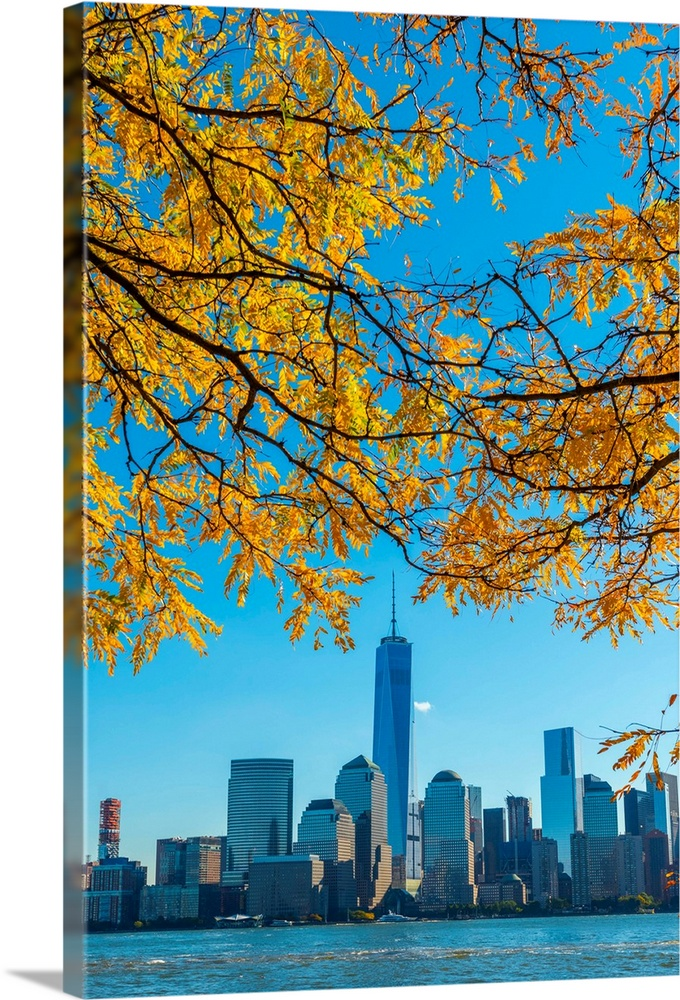 Large Solid-Faced Canvas Print Wall Art Print 24 x 36 entitled New York, Manhattan, World Trade Center, Freedom Tower Solid-Faced Canvas Print entitled New York, Manhattan, World Trade Center, Freedom Tower.  USA, New York, Manhattan, Lower Manhattan and World Trade Center, Freedom Tower, viewed from New Jersey, Jersey City, Paulus Hook.  Multiple sizes available.  Primary colors within this image include Yellow, Brown, Black, Royal Blue.  Made in USA.  All products come with a 365 day workmanship guarantee.  Inks used are latex-based and designed to last.  Canvas depth is 1.25 and includes a finished backing with pre-installed hanging hardware.  Archival inks prevent fading and preserve as much fine detail as possible with no over-saturation or color shifting.