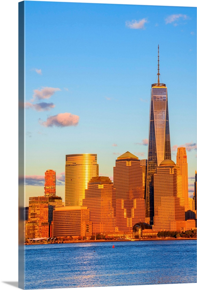 Large Solid-Faced Canvas Print Wall Art Print 24 x 36 entitled New York, Manhattan, World Trade Center, Freedom Tower Solid-Faced Canvas Print entitled New York, Manhattan, World Trade Center, Freedom Tower.  USA, New York, Manhattan, Lower Manhattan and World Trade Center, Freedom Tower.  Multiple sizes available.  Primary colors within this image include Orange, Brown, Sky Blue, Black.  Made in USA.  All products come with a 365 day workmanship guarantee.  Inks used are latex-based and designed to last.  Canvas is handcrafted and made-to-order in the United States using high quality artist-grade canvas.  Canvas depth is 1.25 and includes a finished backing with pre-installed hanging hardware.