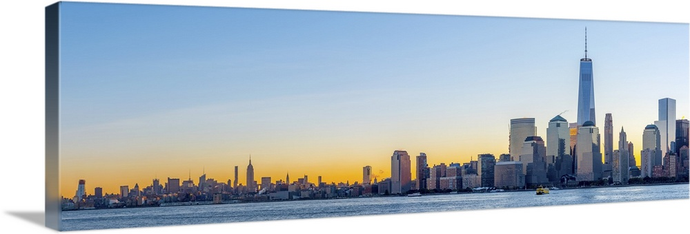 Large Solid-Faced Canvas Print Wall Art Print 60 x 20 entitled New York, Manhattan, World Trade Center, Freedom Tower Solid-Faced Canvas Print entitled New York, Manhattan, World Trade Center, Freedom Tower.  USA, New York, Manhattan, Lower Manhattan and World Trade Center, Freedom Tower.  Multiple sizes available.  Primary colors within this image include Dark Yellow, Peach, Pale Blue, Dark Navy Blue.  Made in USA.  Satisfaction guaranteed.  Archival-quality UV-resistant inks.  Featuring a proprietary design, our canvases produce the tightest corners without any bubbles, ripples, or bumps and will not warp or sag over time.  Archival inks prevent fading and preserve as much fine detail as possible with no over-saturation or color shifting.