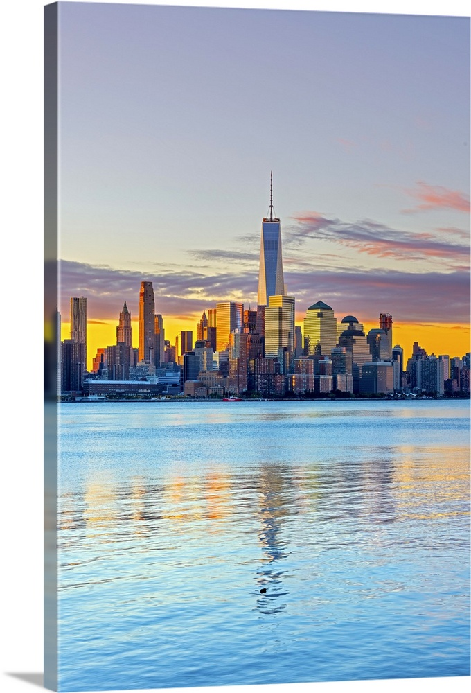 Large Solid-Faced Canvas Print Wall Art Print 24 x 36 entitled New York, Manhattan, World Trade Center, Freedom Tower acro... Solid-Faced Canvas Print entitled New York, Manhattan, World Trade Center, Freedom Tower across Hudson River.  USA, New York, Manhattan, Lower Manhattan and World Trade Center, Freedom Tower across Hudson River.  Multiple sizes available.  Primary colors within this image include Yellow, Peach, Pale Blue, Dark Navy Blue.  Made in USA.  All products come with a 365 day workmanship guarantee.  Inks used are latex-based and designed to last.  Archival inks prevent fading and preserve as much fine detail as possible with no over-saturation or color shifting.  Canvas is handcrafted and made-to-order in the United States using high quality artist-grade canvas.
