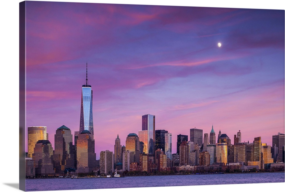 Large Solid-Faced Canvas Print Wall Art Print 36 x 24 entitled New York, New York City, lower Manhattan and Freedom Tower Solid-Faced Canvas Print entitled New York, New York City, lower Manhattan and Freedom Tower.  USA, New York, New York City, lower Manhattan and Freedom Tower, dusk.  Multiple sizes available.  Primary colors within this image include Pink, Peach, Lilac, Black.  Made in USA.  All products come with a 365 day workmanship guarantee.  Inks used are latex-based and designed to last.  Canvas depth is 1.25 and includes a finished backing with pre-installed hanging hardware.  Featuring a proprietary design, our canvases produce the tightest corners without any bubbles, ripples, or bumps and will not warp or sag over time.