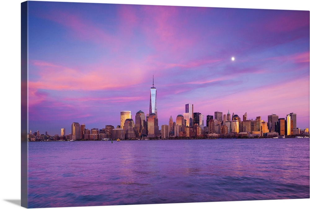 Large Solid-Faced Canvas Print Wall Art Print 36 x 24 entitled New York, New York City, lower Manhattan and Freedom Tower Solid-Faced Canvas Print entitled New York, New York City, lower Manhattan and Freedom Tower.  USA, New York, New York City, lower Manhattan and Freedom Tower, dusk.  Multiple sizes available.  Primary colors within this image include Peach, Lilac, Dark Gray.  Made in the USA.  Satisfaction guaranteed.  Inks used are latex-based and designed to last.  Canvas depth is 1.25 and includes a finished backing with pre-installed hanging hardware.  Archival inks prevent fading and preserve as much fine detail as possible with no over-saturation or color shifting.