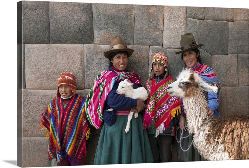 Large Gallery-Wrapped Canvas Wall Art Print 24 x 16 entitled Peru, Cusco, Quechua people standing in front of an Inca wall Gallery-Wrapped Canvas entitled Peru, Cusco, Quechua people standing in front of an Inca wall.  South America, Peru, Cusco. Quechua people standing in front of an Inca wall, holding a lamb and a llama and wearing traditional clothing including a bowler hat, liclla, chullo and poncho  - while talking on a cell phone in the UNESCO World Heritage listed former Inca capital of Cusco MR.  Multiple sizes available.  Primary colors within this image include Orange, Plum, Black, Gray.  Made in USA.  All products come with a 365 day workmanship guarantee.  Inks used are latex-based and designed to last.  Canvas is acid-free and 20 millimeters thick.  Canvas is designed to prevent fading.