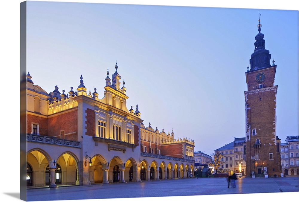 Large Solid-Faced Canvas Print Wall Art Print 30 x 20 entitled Town Hall Tower and Cloth Hall, Market Square, Krakow, Poland Solid-Faced Canvas Print entitled Town Hall Tower and Cloth Hall, Market Square, Krakow, Poland.  Town Hall Tower and Cloth Hall, Market Square, Krakow, Poland, Europe.  Multiple sizes available.  Primary colors within this image include Brown, Peach, Sky Blue, Muted Blue.  Made in the USA.  All products come with a 365 day workmanship guarantee.  Inks used are latex-based and designed to last.  Featuring a proprietary design, our canvases produce the tightest corners without any bubbles, ripples, or bumps and will not warp or sag over time.  Canvas depth is 1.25 and includes a finished backing with pre-installed hanging hardware.
