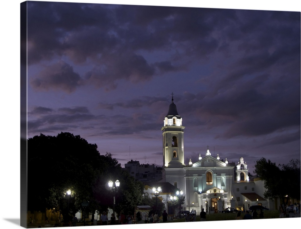 Large Solid-Faced Canvas Print Wall Art Print 40 x 30 entitled Recoleta Gardens and Iglesia del Pilar Solid-Faced Canvas Print entitled Recoleta Gardens and Iglesia del Pilar.  Argentina Buenos Aires, Recoleta Gardens and Iglesia del Pilar, Pilar church, at dusk.  Multiple sizes available.  Primary colors within this image include Black, Silver, Muted Blue.  Made in USA.  All products come with a 365 day workmanship guarantee.  Inks used are latex-based and designed to last.  Canvas is handcrafted and made-to-order in the United States using high quality artist-grade canvas.  Canvas depth is 1.25 and includes a finished backing with pre-installed hanging hardware.