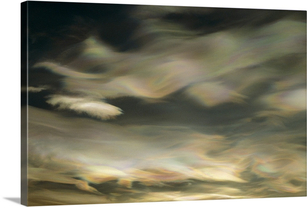 Large Gallery-Wrapped Canvas Wall Art Print 24 x 16 entitled Nacreous Mother of Pearl' clouds seen over Ross Island in lat... Gallery-Wrapped Canvas entitled Nacreous Mother of Pearl clouds seen over Ross Island in late winter  Antarctica.  An abstract artwork piece of clouds in a winter sky. There is a pearl essence and wave like appearance to the clouds.  Multiple sizes available.  Primary colors within this image include Peach Dark Forest Green.  Made in the USA.  All products come with a 365 day workmanship guarantee.  Inks used are latex-based and designed to last.  Canvas is a 65 polyester 35 cotton base with two acrylic latex primer basecoats and a semi-gloss inkjet receptive topcoat.  Canvases have a UVB protection built in to protect against fading and moisture and are designed to last for over 100 years.