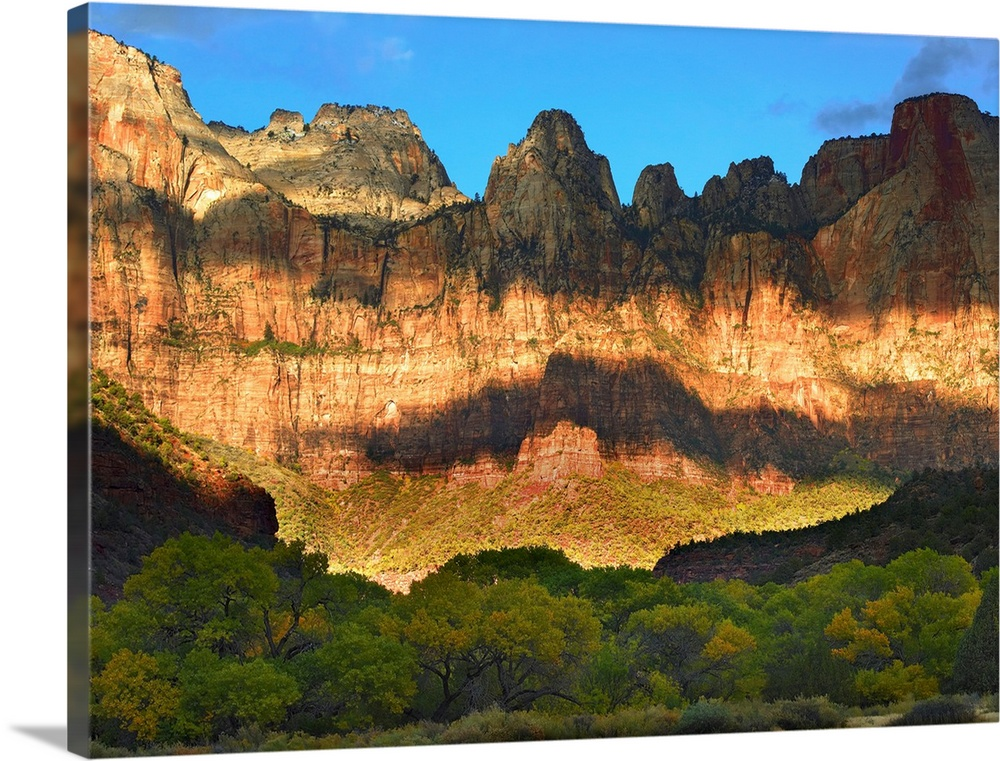 Large Solid-Faced Canvas Print Wall Art Print 40 x 30 entitled Towers of the Virgin with cloud shadows, Zion National Park... Solid-Faced Canvas Print entitled Towers of the Virgin with cloud shadows, Zion National Park, Utah.  Multiple sizes available.  Primary colors within this image include Brown, Peach, Sky Blue, White.  Made in USA.  Satisfaction guaranteed.  Archival-quality UV-resistant inks.  Featuring a proprietary design, our canvases produce the tightest corners without any bubbles, ripples, or bumps and will not warp or sag over time.  Canvas depth is 1.25 and includes a finished backing with pre-installed hanging hardware.