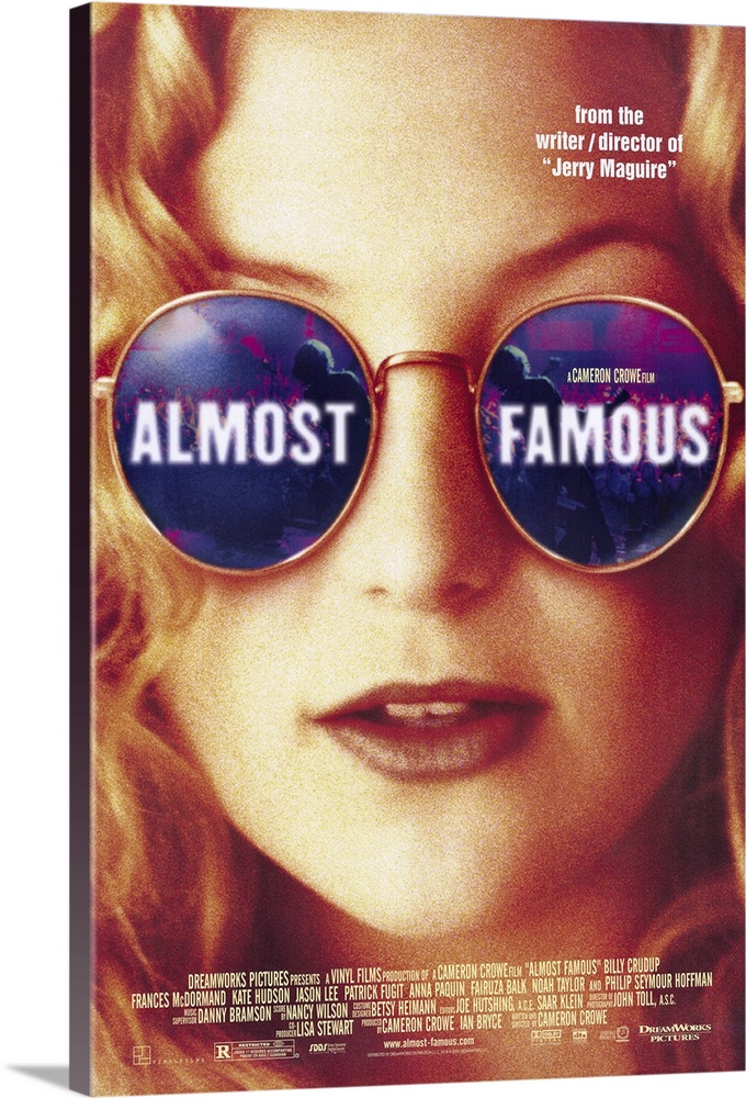 Large Gallery-Wrapped Canvas Wall Art Print 16 x 24 entitled Almost Famous (2000) Gallery-Wrapped Canvas entitled Almost Famous 2000.  Fifteen-year-old budding rock critic William Millers Fugit dream comes true after he bluffs his way into a Rolling Stone writing assignment covering a rising 70s rock band on tour. This ode to the music and youth culture of that decade may lack grit but its sympathetic treatment of young Millers coming-of-age amid groupies drugs rock and roll and a worried undupable mother McDormand achieves director Crowes ends. The films adoration of the musics energy and emotion appear to be the headliner here but it never outperforms its devotion to character and relationship. Delicate performances by first-timer Fugit and by Hudson as the more-than-a-groupie groupie plus a memorable portrayal of the wise and slightly surly critic Lester Bangs by Hoffman. Based on Crowes own experiences.  Multiple sizes available.  Primary colors within this image include Dark Red Peach White Muted Blue.  Made in USA.  All products come with a 365 day workmanship guarantee.  Inks used are latex-based and designed to last.  Museum-quality artist-grade canvas mounted on sturdy wooden stretcher bars 1.5 thick.  Comes ready to hang.  Canvases are stretched across a 1.5 inch thick wooden frame with easy-to-mount hanging hardware.