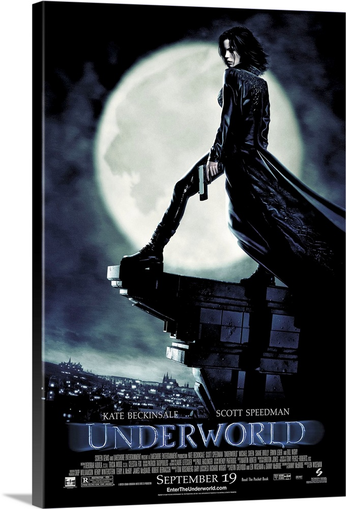 Large Solid-Faced Canvas Print Wall Art Print 20 x 30 entitled Underworld (2003) Solid-Faced Canvas Print entitled Underworld 2003.  Large, vertical movie advertisement for Underworld, main character Selene stands with a gun in her hand, on the edge of the top of a building, against a large moon, overlooking the lit city at night.  The shadow of a beast resides in the surface of the moon.  Movie title and credits are at the bottom of the image.  Multiple sizes available.  Primary colors within this image include Black, Gray, White.  Made in USA.  All products come with a 365 day workmanship guarantee.  Archival-quality UV-resistant inks.  Archival inks prevent fading and preserve as much fine detail as possible with no over-saturation or color shifting.  Featuring a proprietary design, our canvases produce the tightest corners without any bubbles, ripples, or bumps and will not warp or sag over time.