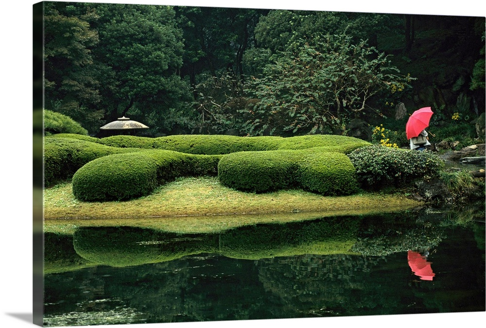Large Solid-Faced Canvas Print Wall Art Print 30 x 20 entitled A lone person sits in a garden at Tokyos Imperial Palace Solid-Faced Canvas Print entitled A lone person sits in a garden at Tokyos Imperial Palace.  Tokyo, Japan.  Multiple sizes available.  Primary colors within this image include Pink, Light Green, Black, Dark Forest Green.  Made in USA.  Satisfaction guaranteed.  Inks used are latex-based and designed to last.  Canvas is handcrafted and made-to-order in the United States using high quality artist-grade canvas.  Archival inks prevent fading and preserve as much fine detail as possible with no over-saturation or color shifting.