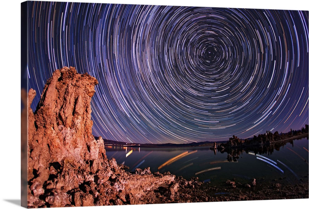 Large Solid-Faced Canvas Print Wall Art Print 30 x 20 entitled A moonlit time exposure sky's rotation around the star Polaris Solid-Faced Canvas Print entitled A moonlit time exposure skys rotation around the star Polaris.  A moonlit time exposure skys rotation around the star Polaris.  Multiple sizes available.  Primary colors within this image include Blue, Dark Red, White, Dark Navy Blue.  Made in USA.  Satisfaction guaranteed.  Inks used are latex-based and designed to last.  Canvas depth is 1.25 and includes a finished backing with pre-installed hanging hardware.  Canvas is handcrafted and made-to-order in the United States using high quality artist-grade canvas.