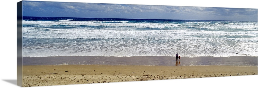 Large Gallery-Wrapped Canvas Wall Art Print 36 x 13 entitled A mother and son stand on a wide windswept beach watching foa... Gallery-Wrapped Canvas entitled A mother and son stand on a wide windswept beach watching foamy waves.  Panoramic print of a parent and a child standing showing up really small against the wide beach with waves washing ashore.  Multiple sizes available.  Primary colors within this image include Silver Muted Blue Dark Forest Green.  Made in the USA.  All products come with a 365 day workmanship guarantee.  Inks used are latex-based and designed to last.  Canvas is a 65 polyester 35 cotton base with two acrylic latex primer basecoats and a semi-gloss inkjet receptive topcoat.  Museum-quality artist-grade canvas mounted on sturdy wooden stretcher bars 1.5 thick.  Comes ready to hang.
