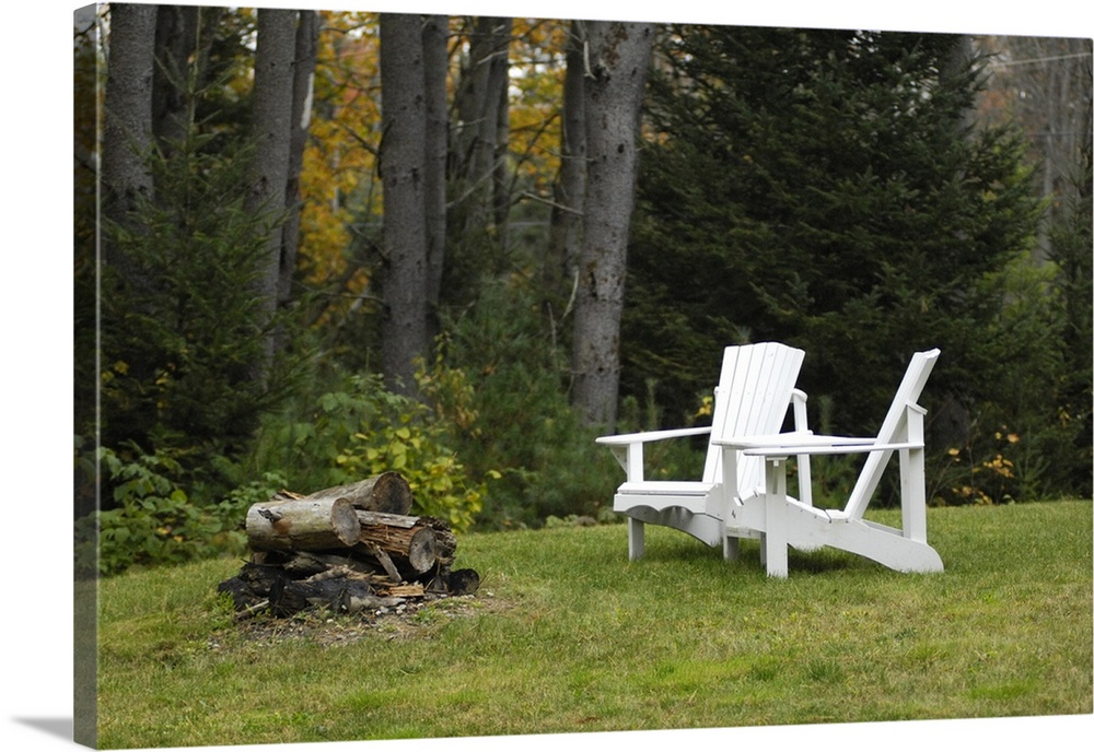 Large Solid-Faced Canvas Print Wall Art Print 30 x 20 entitled Adirondack wooden chairs and a fire pit in forest, Durham, ... Solid-Faced Canvas Print entitled Adirondack wooden chairs and a fire pit in forest, Durham, Maine.  Adirondack wooden chairs and a fire pit in forest, Durham, Maine.  Multiple sizes available.  Primary colors within this image include Dark Yellow, Dark Gray, White.  Made in USA.  All products come with a 365 day workmanship guarantee.  Inks used are latex-based and designed to last.  Canvas is handcrafted and made-to-order in the United States using high quality artist-grade canvas.  Featuring a proprietary design, our canvases produce the tightest corners without any bubbles, ripples, or bumps and will not warp or sag over time.