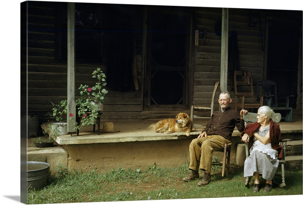 Large Gallery-Wrapped Canvas Wall Art Print 24 x 16 entitled Albemarle County, Virginia Gallery-Wrapped Canvas entitled Albemarle County, Virginia.  Rural couple sits in chairs on lawn dog lies on shady porch nearby.  Multiple sizes available.  Primary colors within this image include Black, Silver, Dark Forest Green.  Made in USA.  Satisfaction guaranteed.  Inks used are latex-based and designed to last.  Canvas is acid-free and 20 millimeters thick.  Canvases have a UVB protection built in to protect against fading and moisture and are designed to last for over 100 years.