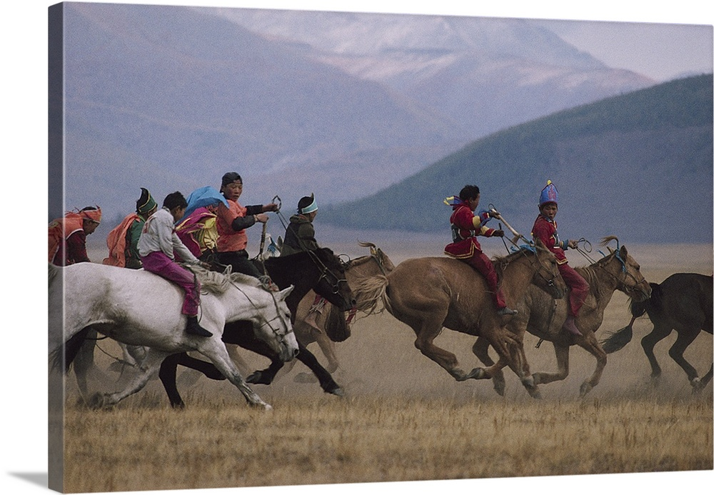 Large Solid-Faced Canvas Print Wall Art Print 30 x 20 entitled Bareback & barefoot colorfully clothed kids ride across Dar.. Solid-Faced Canvas Print entitled Bareback  barefoot colorfully clothed kids ride across Darhad valley.  Mongolia.  Multiple sizes available.  Primary colors within this image include Dark Gray, Light Gray.  Made in USA.  All products come with a 365 day workmanship guarantee.  Archival-quality UV-resistant inks.  Archival inks prevent fading and preserve as much fine detail as possible with no over-saturation or color shifting.  Canvas depth is 1.25 and includes a finished backing with pre-installed hanging hardware.