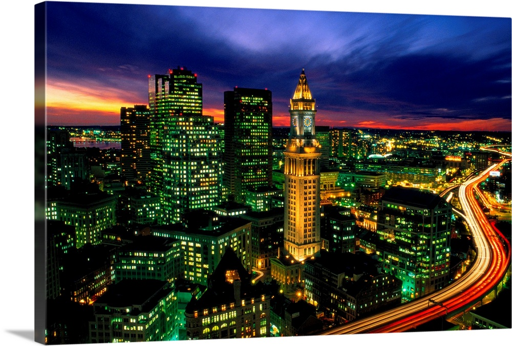 Large Solid-Faced Canvas Print Wall Art Print 30 x 20 entitled Boston night aerial with time exposure car lights on Centra... Solid-Faced Canvas Print entitled Boston night aerial with time exposure car lights on Central Artery.  Time lapsed evening photograph of the Custom House Tower and the highway that passes in front of it.  Multiple sizes available.  Primary colors within this image include Dark Red, Dark Blue, Light Green, Black.  Made in the USA.  All products come with a 365 day workmanship guarantee.  Archival-quality UV-resistant inks.  Canvas is handcrafted and made-to-order in the United States using high quality artist-grade canvas.  Archival inks prevent fading and preserve as much fine detail as possible with no over-saturation or color shifting.