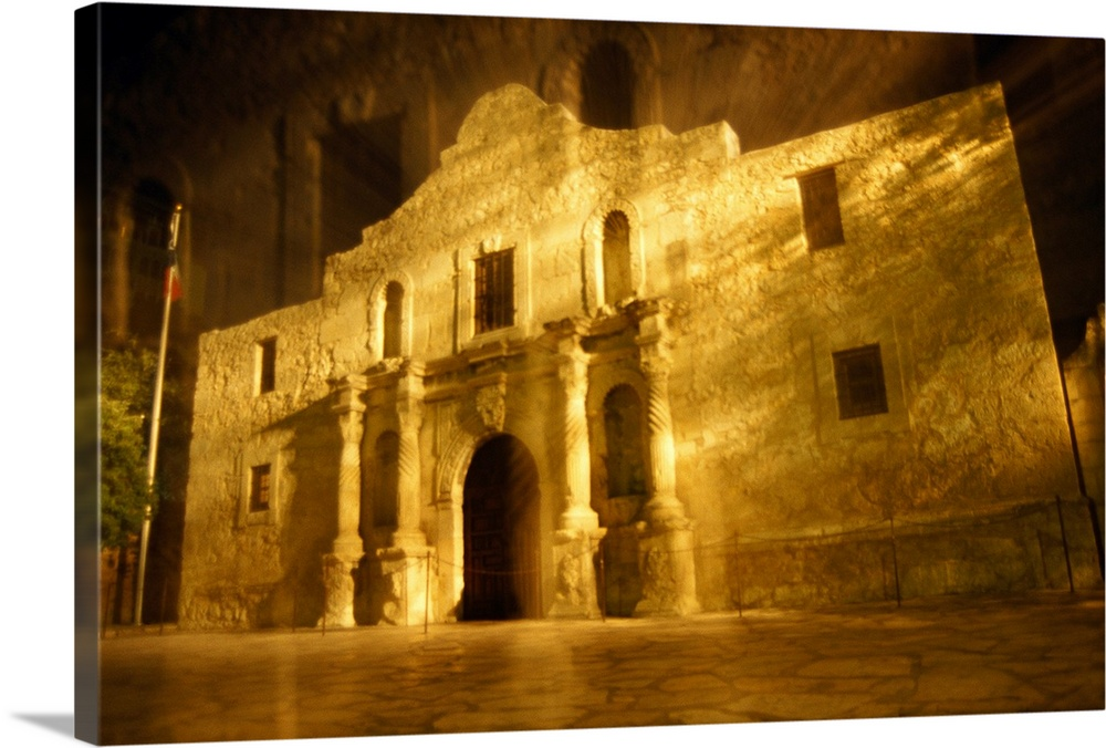 Large Solid-Faced Canvas Print Wall Art Print 30 x 20 entitled Night time exposed zoom gives haunting view of Texas histor... Solid-Faced Canvas Print entitled Night time exposed zoom gives haunting view of Texas historic Alamo.  The Alamo, San Antonio, Texas.  Multiple sizes available.  Primary colors within this image include Brown, Peach, Black.  Made in the USA.  Satisfaction guaranteed.  Archival-quality UV-resistant inks.  Archival inks prevent fading and preserve as much fine detail as possible with no over-saturation or color shifting.  Canvas depth is 1.25 and includes a finished backing with pre-installed hanging hardware.