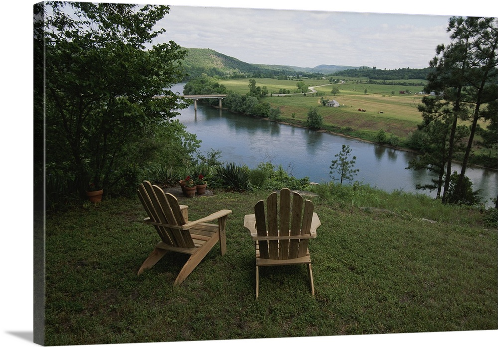 Large Gallery-Wrapped Canvas Wall Art Print 24 x 16 entitled Ozark Mountains, Arkansas Gallery-Wrapped Canvas entitled Ozark Mountains, Arkansas.  Two Adirondack chairs on a scenic overlook.  Multiple sizes available.  Primary colors within this image include Silver, Muted Blue, Dark Forest Green.  Made in the USA.  Satisfaction guaranteed.  Archival-quality UV-resistant inks.  Canvas is a 65 polyester, 35 cotton base, with two acrylic latex primer basecoats and a semi-gloss inkjet receptive topcoat.  Museum-quality, artist-grade canvas mounted on sturdy wooden stretcher bars 1.5 thick.  Comes ready to hang.