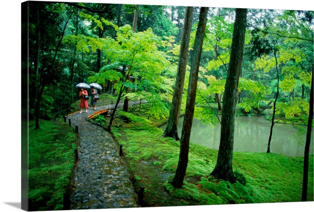 Large Solid-Faced Canvas Print Wall Art Print 30 x 20 entitled Visitors stroll down a stone path in a Japanese garden, Japan Solid-Faced Canvas Print entitled Visitors stroll down a stone path in a Japanese garden, Japan.  Multiple sizes available.  Primary colors within this image include Forest Green, Pink, Black, Lime Green.  Made in the USA.  All products come with a 365 day workmanship guarantee.  Archival-quality UV-resistant inks.  Featuring a proprietary design, our canvases produce the tightest corners without any bubbles, ripples, or bumps and will not warp or sag over time.  Canvas depth is 1.25 and includes a finished backing with pre-installed hanging hardware.