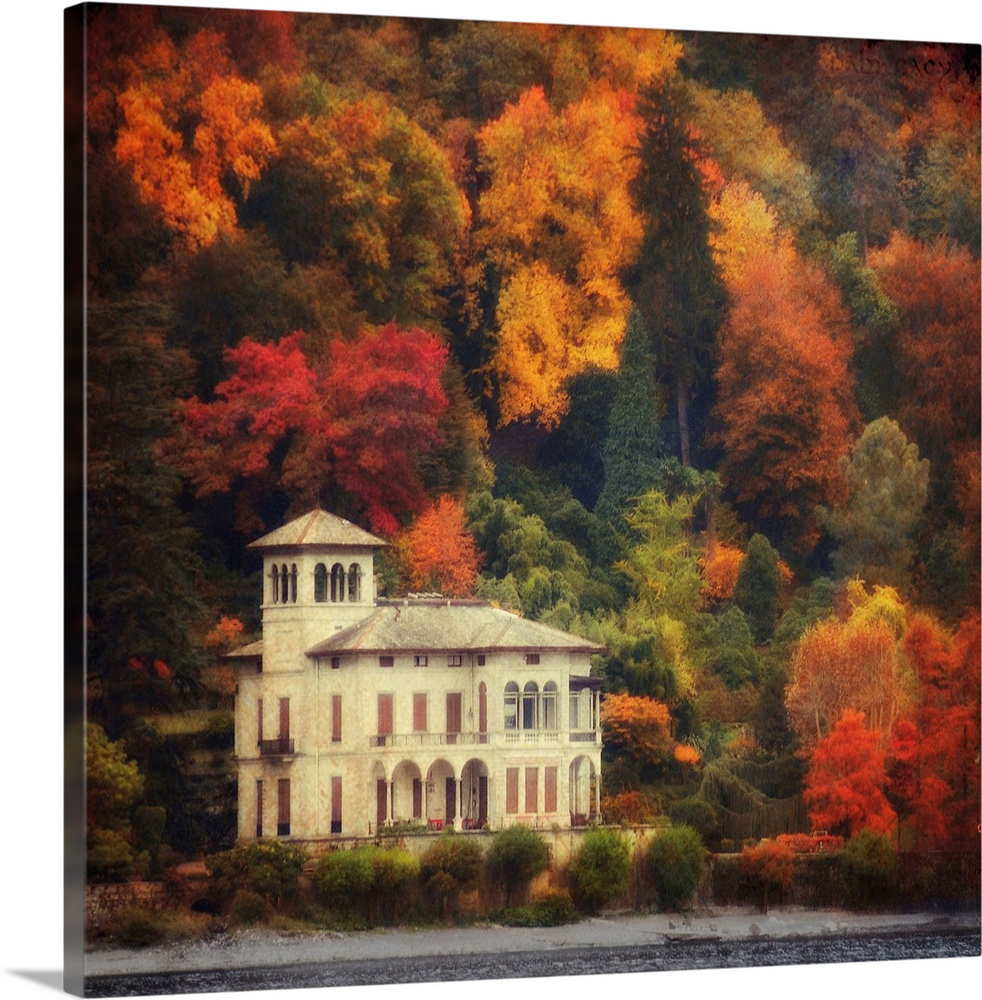 Large Solid-Faced Canvas Print Wall Art Print 20 x 20 entitled Autumn in my Garden Solid-Faced Canvas Print entitled Autumn in my Garden.  This is a landscape photograph on square shaped wall docor that shows a lake side villa surrounded by a forest of fall foliage.  Multiple sizes available.  Primary colors within this image include Orange, Dark Red, Black, Silver.  Made in USA.  All products come with a 365 day workmanship guarantee.  Archival-quality UV-resistant inks.  Archival inks prevent fading and preserve as much fine detail as possible with no over-saturation or color shifting.  Featuring a proprietary design, our canvases produce the tightest corners without any bubbles, ripples, or bumps and will not warp or sag over time.