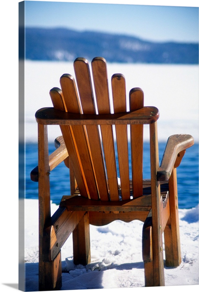 Large Solid-Faced Canvas Print Wall Art Print 20 x 30 entitled Empty Adirondack Chair on the Deck in Winter, Lake George, ... Solid-Faced Canvas Print entitled Empty Adirondack Chair on the Deck in Winter, Lake George, New Y.  Empty Adirondack Chair on the Deck in Winter, Lake George, New York.  Multiple sizes available.  Primary colors within this image include Orange, Dark Red, White, Royal Blue.  Made in the USA.  All products come with a 365 day workmanship guarantee.  Archival-quality UV-resistant inks.  Archival inks prevent fading and preserve as much fine detail as possible with no over-saturation or color shifting.  Featuring a proprietary design, our canvases produce the tightest corners without any bubbles, ripples, or bumps and will not warp or sag over time.
