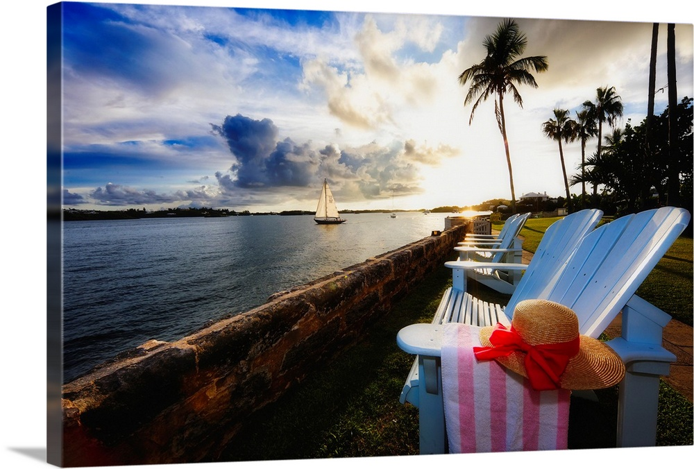 Large Solid-Faced Canvas Print Wall Art Print 30 x 20 entitled Hamilton Bay Sunset with Lounge Chairs, Bermuda Solid-Faced Canvas Print entitled Hamilton Bay Sunset with Lounge Chairs, Bermuda.  Multiple sizes available.  Primary colors within this image include Dark Red, Dark Blue, Black, Silver.  Made in the USA.  All products come with a 365 day workmanship guarantee.  Inks used are latex-based and designed to last.  Archival inks prevent fading and preserve as much fine detail as possible with no over-saturation or color shifting.  Canvas is handcrafted and made-to-order in the United States using high quality artist-grade canvas.