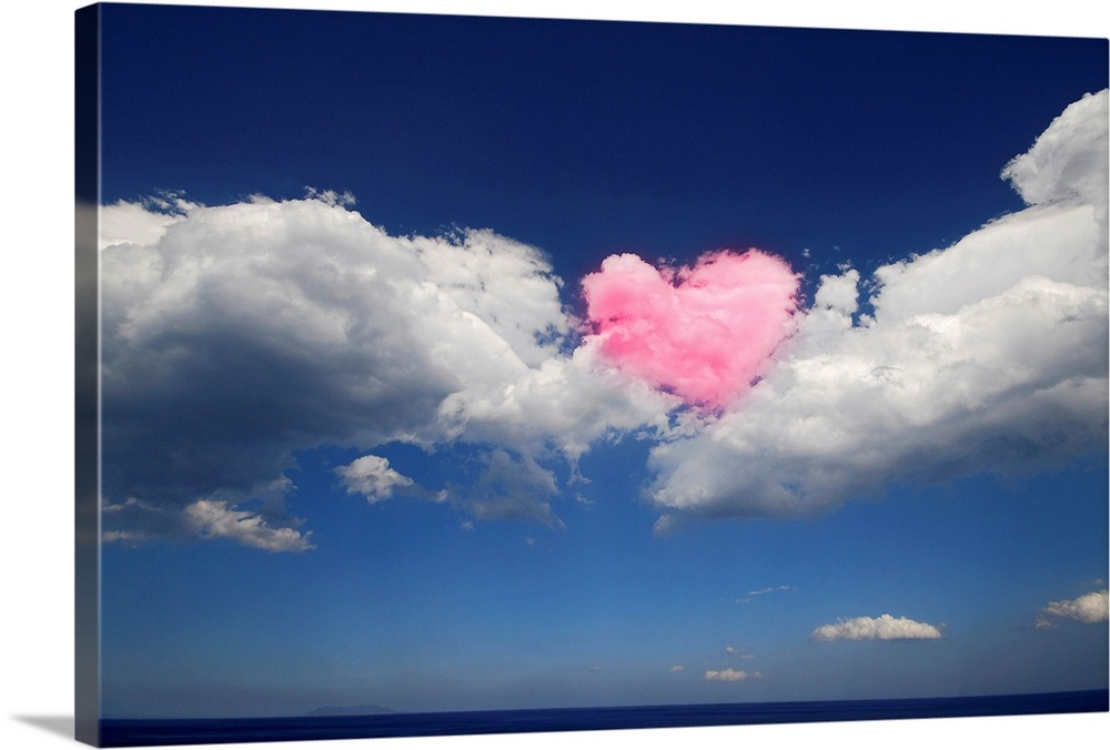Large Solid-Faced Canvas Print Wall Art Print 30 x 20 entitled Love is in the Air Solid-Faced Canvas Print entitled Love is in the Air.  This large piece shows immense clouds with a heart shaped cloud in the middle that has been colored pink.  Multiple sizes available.  Primary colors within this image include Light Purple, Gray, White, Muted Blue.  Made in USA.  Satisfaction guaranteed.  Archival-quality UV-resistant inks.  Canvas depth is 1.25 and includes a finished backing with pre-installed hanging hardware.  Featuring a proprietary design, our canvases produce the tightest corners without any bubbles, ripples, or bumps and will not warp or sag over time.