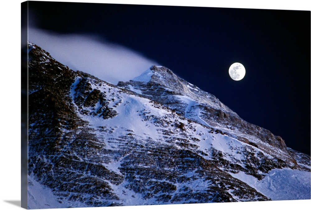 Large Solid-Faced Canvas Print Wall Art Print 30 x 20 entitled Moon Shadow Solid-Faced Canvas Print entitled Moon Shadow.  Mount Everest, Tibet, China.  Multiple sizes available.  Primary colors within this image include Sky Blue, Black.  Made in USA.  All products come with a 365 day workmanship guarantee.  Archival-quality UV-resistant inks.  Archival inks prevent fading and preserve as much fine detail as possible with no over-saturation or color shifting.  Canvas is handcrafted and made-to-order in the United States using high quality artist-grade canvas.