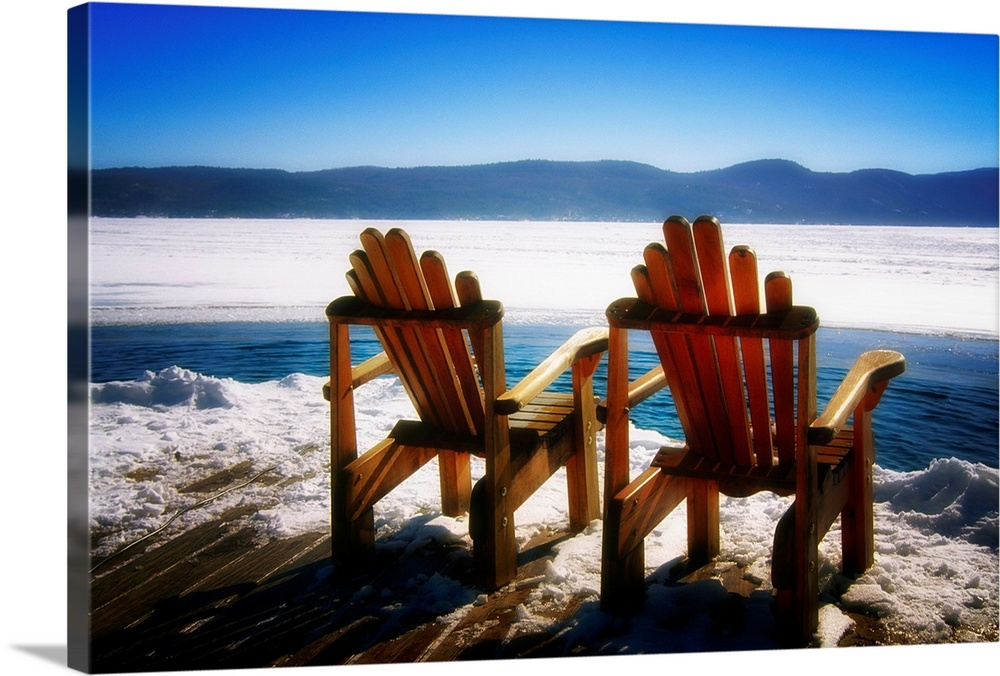 Large Solid-Faced Canvas Print Wall Art Print 30 x 20 entitled Two Adirondack Chairs on a Deck in Winter, Lake George, New... Solid-Faced Canvas Print entitled Two Adirondack Chairs on a Deck in Winter, Lake George, New York.  Multiple sizes available.  Primary colors within this image include Brown, Black, Pale Blue, Royal Blue.  Made in USA.  All products come with a 365 day workmanship guarantee.  Inks used are latex-based and designed to last.  Canvas depth is 1.25 and includes a finished backing with pre-installed hanging hardware.  Featuring a proprietary design, our canvases produce the tightest corners without any bubbles, ripples, or bumps and will not warp or sag over time.