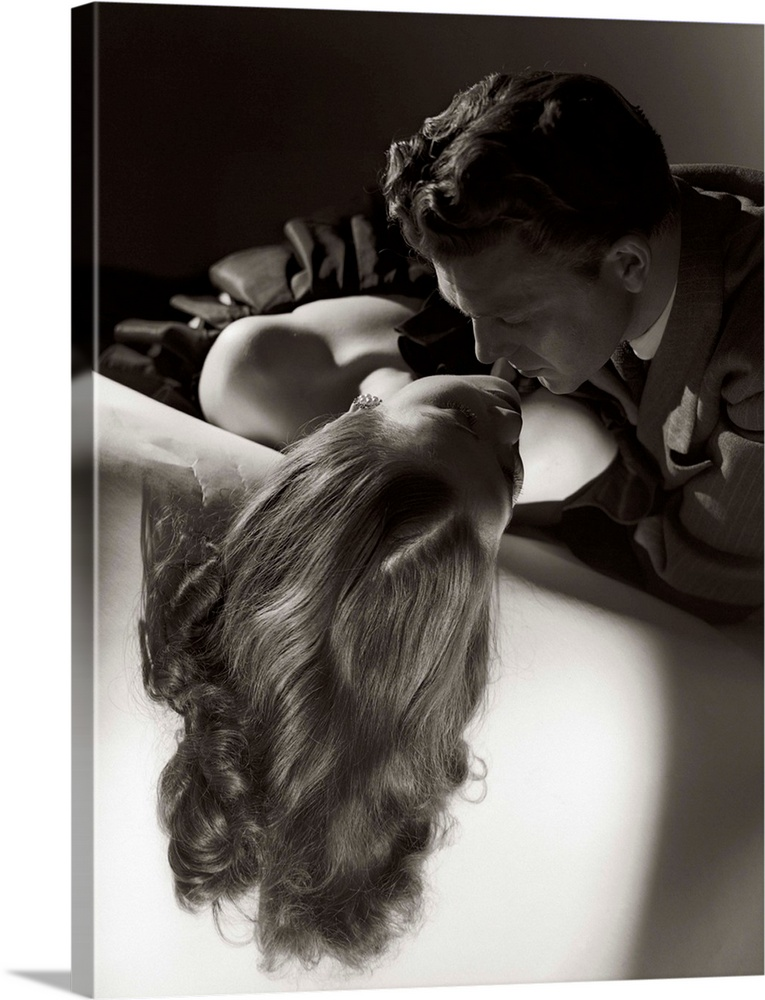 Large Solid-Faced Canvas Print Wall Art Print 30 x 40 entitled 1940s 1950s Silhouetted Romantic Couple Embracing, About To... Solid-Faced Canvas Print entitled 1940s 1950s Silhouetted Romantic Couple Embracing, About To Kiss, Sitting On Sofa.  1940s 1950s Anonymous Silhouetted Romantic Couple Embracing About To Kiss Sitting On Sofa.  Multiple sizes available.  Primary colors within this image include Black, Gray, White.  Made in USA.  Satisfaction guaranteed.  Inks used are latex-based and designed to last.  Canvas is handcrafted and made-to-order in the United States using high quality artist-grade canvas.  Canvas depth is 1.25 and includes a finished backing with pre-installed hanging hardware.