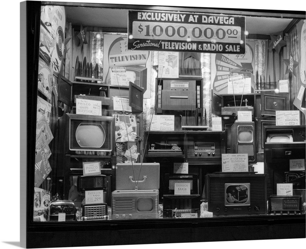 Large Gallery-Wrapped Canvas Wall Art Print 24 x 19 entitled 1940's Window Of Store Selling Radios And Televisions Adverti... Gallery-Wrapped Canvas entitled 1940s Window Of Store Selling Radios And Televisions Advertising A Million Dollar Sale.  1940s Window Of Store Selling Radios And Televisions Advertising A Million Dollar Sale.  Multiple sizes available.  Primary colors within this image include Black, Gray, White.  Made in the USA.  Satisfaction guaranteed.  Inks used are latex-based and designed to last.  Canvases are stretched across a 1.5 inch thick wooden frame with easy-to-mount hanging hardware.  Canvases have a UVB protection built in to protect against fading and moisture and are designed to last for over 100 years.