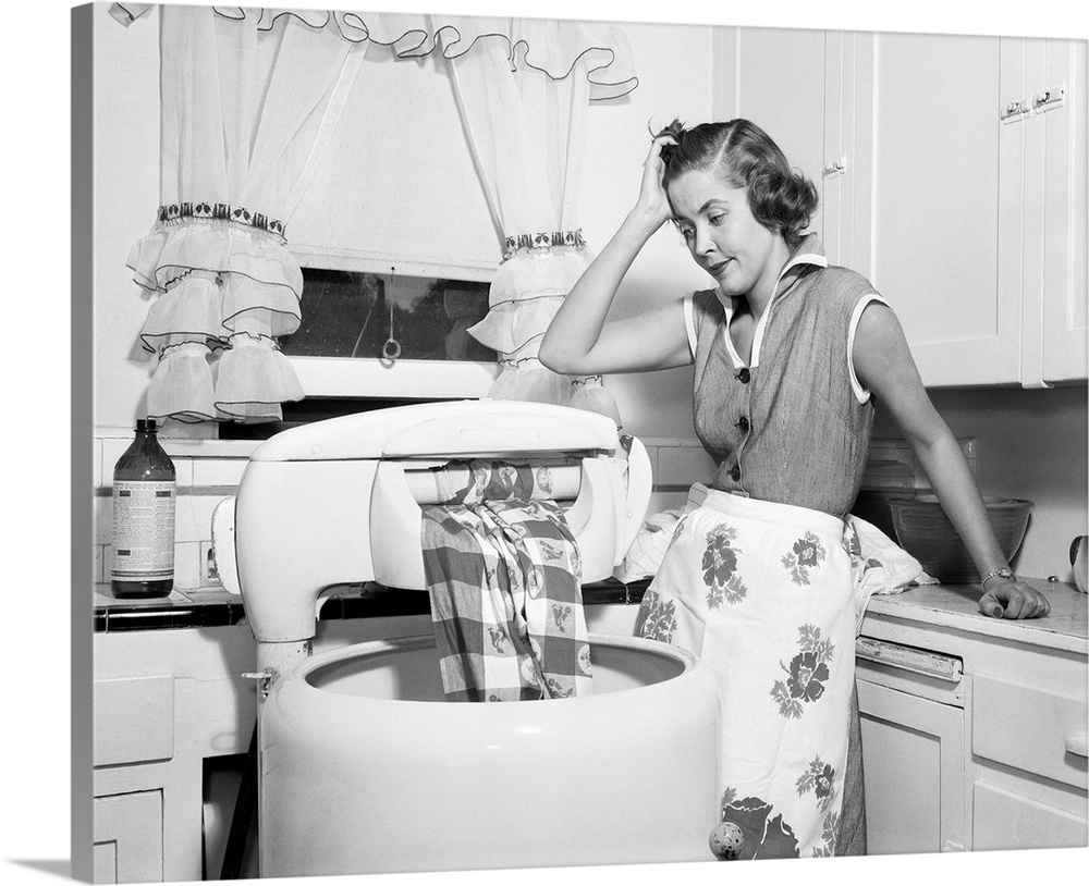 Large Solid-Faced Canvas Print Wall Art Print 30 x 24 entitled 1950s Frustrated Housewife With Jammed Wringer On Clothes W... Solid-Faced Canvas Print entitled 1950s Frustrated Housewife With Jammed Wringer On Clothes Washing Machine In Kitchen.  1950s Frustrated Housewife With Jammed Wringer On Clothes Washing Machine In Kitchen.  Multiple sizes available.  Primary colors within this image include Dark Gray, Silver.  Made in USA.  All products come with a 365 day workmanship guarantee.  Inks used are latex-based and designed to last.  Canvas depth is 1.25 and includes a finished backing with pre-installed hanging hardware.  Canvas is handcrafted and made-to-order in the United States using high quality artist-grade canvas.