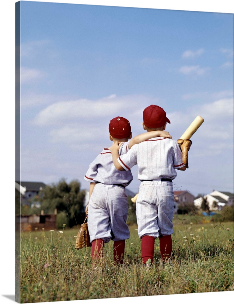Large Solid-Faced Canvas Print Wall Art Print 24 x 30 entitled 1960s Two Boys Brothers Wearing Little League Baseball Unif... Solid-Faced Canvas Print entitled 1960s Two Boys Brothers Wearing Little League Baseball Uniforms, Walking Arm In Arm.  1960s Two Boys Brothers Teammates Wearing Little League Baseball Uniforms Walking Arm In Arm Away From Camera.  Multiple sizes available.  Primary colors within this image include Sky Blue, Black, Gray, White.  Made in the USA.  Satisfaction guaranteed.  Inks used are latex-based and designed to last.  Featuring a proprietary design, our canvases produce the tightest corners without any bubbles, ripples, or bumps and will not warp or sag over time.  Canvas depth is 1.25 and includes a finished backing with pre-installed hanging hardware.