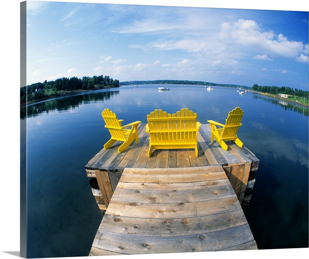 Large Solid-Faced Canvas Print Wall Art Print 30 x 24 entitled Adirondack Chairs on Dock Nova Scotia Canada Solid-Faced Canvas Print entitled Adirondack Chairs on Dock Nova Scotia Canada.  Outdoor wooden chairs sit at the end of a small dock and look out onto a large body of water.  Multiple sizes available.  Primary colors within this image include Dark Yellow, Black, Pale Blue, Royal Blue.  Made in USA.  All products come with a 365 day workmanship guarantee.  Inks used are latex-based and designed to last.  Canvas depth is 1.25 and includes a finished backing with pre-installed hanging hardware.  Archival inks prevent fading and preserve as much fine detail as possible with no over-saturation or color shifting.