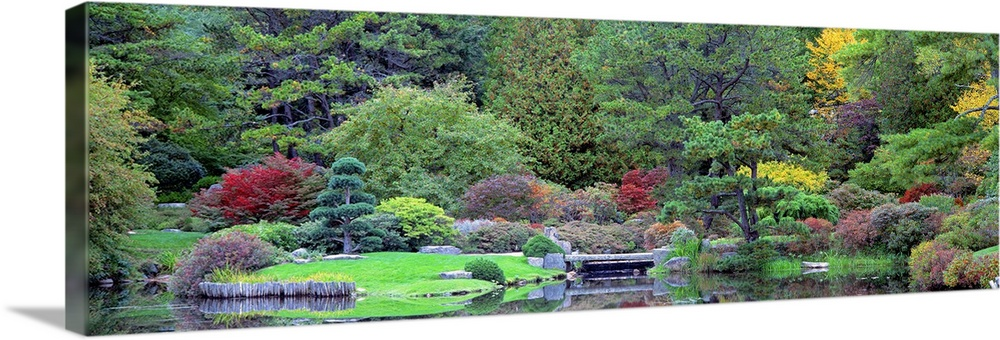 Large Solid-Faced Canvas Print Wall Art Print 48 x 16 entitled Asticou Azalea Gardens Northwest Harbor ME Solid-Faced Canvas Print entitled Asticou Azalea Gardens Northwest Harbor ME.  Panoramic photograph taken of lush and dense foliage that grows behind a small body of water.  Multiple sizes available.  Primary colors within this image include Light Yellow, Black, Gray, White.  Made in the USA.  Satisfaction guaranteed.  Inks used are latex-based and designed to last.  Featuring a proprietary design, our canvases produce the tightest corners without any bubbles, ripples, or bumps and will not warp or sag over time.  Canvas is handcrafted and made-to-order in the United States using high quality artist-grade canvas.