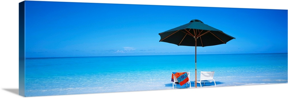 Large Gallery-Wrapped Canvas Wall Art Print 30 x 10 entitled Atlantic Ocean Turks And Caicos Islands Gallery-Wrapped Canvas entitled Atlantic Ocean Turks And Caicos Islands .  Two beach chairs under an umbrella in front of the ocean in the sand on the Turks and Caicos Islands.  Multiple sizes available.  Primary colors within this image include Dark Red, Sky Blue, Royal Blue, Dark Navy Blue.  Made in the USA.  All products come with a 365 day workmanship guarantee.  Archival-quality UV-resistant inks.  Canvas frames are built with farmed or reclaimed domestic pine or poplar wood.  Canvases are stretched across a 1.5 inch thick wooden frame with easy-to-mount hanging hardware.