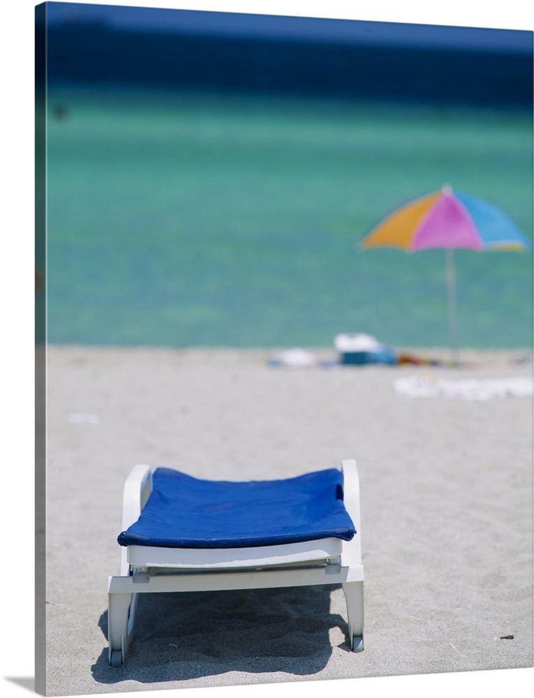 Large Solid-Faced Canvas Print Wall Art Print 24 x 30 entitled Beach Chair and Umbrella Miami Beach FL Solid-Faced Canvas Print entitled Beach Chair and Umbrella Miami Beach FL.  Multiple sizes available.  Primary colors within this image include Peach, Lilac, Silver, Dark Navy Blue.  Made in the USA.  Satisfaction guaranteed.  Archival-quality UV-resistant inks.  Archival inks prevent fading and preserve as much fine detail as possible with no over-saturation or color shifting.  Canvas is handcrafted and made-to-order in the United States using high quality artist-grade canvas.