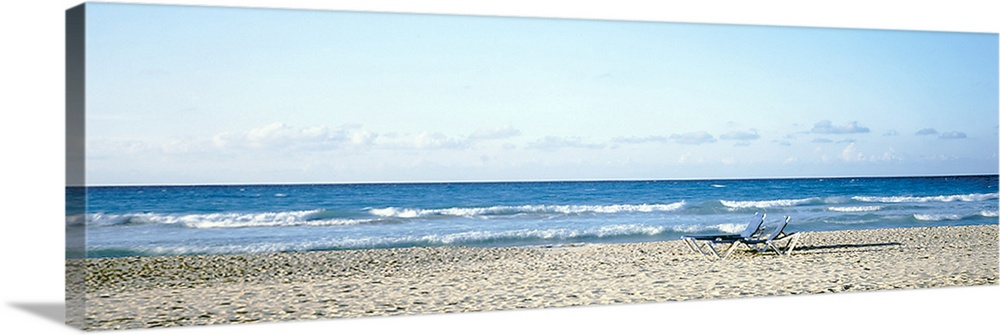 Large Solid-Faced Canvas Print Wall Art Print 48 x 16 entitled Beach Chairs Cuba Solid-Faced Canvas Print entitled Beach Chairs Cuba.  Multiple sizes available.  Primary colors within this image include Black, White, Dark Forest Green, Royal Blue.  Made in USA.  Satisfaction guaranteed.  Inks used are latex-based and designed to last.  Canvas is handcrafted and made-to-order in the United States using high quality artist-grade canvas.  Canvas depth is 1.25 and includes a finished backing with pre-installed hanging hardware.