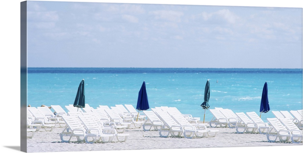 Large Gallery-Wrapped Canvas Wall Art Print 30 x 16 entitled Beach Chairs South Beach Miami Beach FL Gallery-Wrapped Canvas entitled Beach Chairs South Beach Miami Beach FL.  Multiple sizes available.  Primary colors within this image include Dark Blue, Pale Blue, Dark Navy Blue.  Made in the USA.  Satisfaction guaranteed.  Archival-quality UV-resistant inks.  Canvas is designed to prevent fading.  Canvas is a 65 polyester, 35 cotton base, with two acrylic latex primer basecoats and a semi-gloss inkjet receptive topcoat.