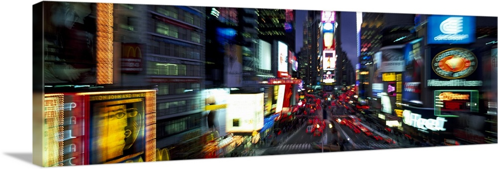 Large Solid-Faced Canvas Print Wall Art Print 48 x 16 entitled Blurred view of a city, Times Square, Manhattan, New York C... Solid-Faced Canvas Print entitled Blurred view of a city, Times Square, Manhattan, New York City, New York State.  Blurred view of a city, Times Square, Manhattan, New York City, New York State, USA.  Multiple sizes available.  Primary colors within this image include Yellow, Brown, White, Royal Blue.  Made in USA.  Satisfaction guaranteed.  Inks used are latex-based and designed to last.  Canvas depth is 1.25 and includes a finished backing with pre-installed hanging hardware.  Canvas is handcrafted and made-to-order in the United States using high quality artist-grade canvas.