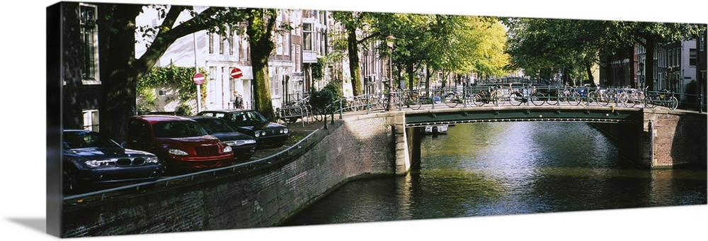 Solid-Faced Canvas Print Wall Art entitled Bridge across a channel, Amsterdam,