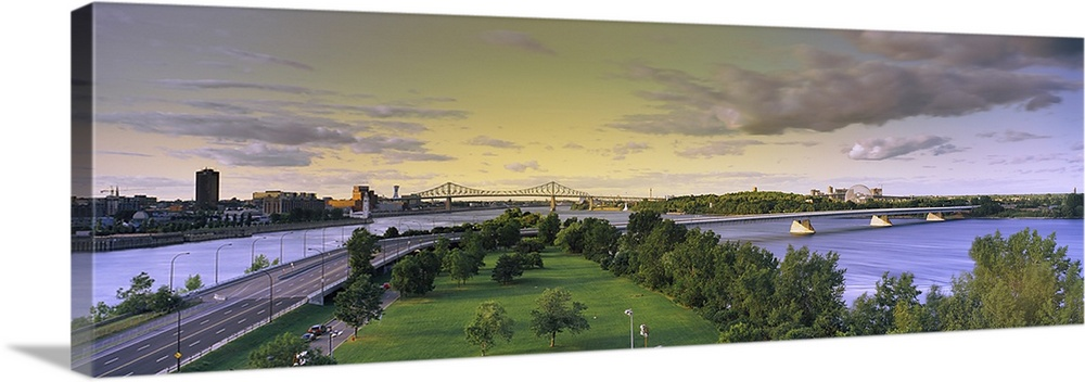 Large Gallery-Wrapped Canvas Wall Art Print 30 x 10 entitled Bridges across a river, Jacques Cartier Bridge, Pont De La Co... Gallery-Wrapped Canvas entitled Bridges across a river, Jacques Cartier Bridge, Pont De La Concorde, Montreal.  Bridges across a river, Jacques Cartier Bridge, Pont De La Concorde, Montreal, Quebec, Canada.  Multiple sizes available.  Primary colors within this image include Sky Blue, Dark Gray, Light Gray.  Made in USA.  All products come with a 365 day workmanship guarantee.  Inks used are latex-based and designed to last.  Canvas frames are built with farmed or reclaimed domestic pine or poplar wood.  Canvas is a 65 polyester, 35 cotton base, with two acrylic latex primer basecoats and a semi-gloss inkjet receptive topcoat.
