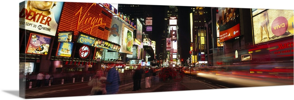 Large Solid-Faced Canvas Print Wall Art Print 48 x 16 entitled Buildings in a city, Broadway, Times Square, Midtown Manhat... Solid-Faced Canvas Print entitled Buildings in a city, Broadway, Times Square, Midtown Manhattan, Manhattan, New York City, New York State.  Multiple sizes available.  Primary colors within this image include Dark Red, Light Yellow, Black, White.  Made in the USA.  All products come with a 365 day workmanship guarantee.  Inks used are latex-based and designed to last.  Archival inks prevent fading and preserve as much fine detail as possible with no over-saturation or color shifting.  Featuring a proprietary design, our canvases produce the tightest corners without any bubbles, ripples, or bumps and will not warp or sag over time.
