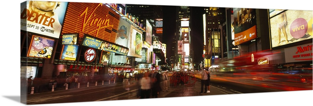 Large Solid-Faced Canvas Print Wall Art Print 48 x 16 entitled Buildings in a city, Broadway, Times Square, Midtown Manhat... Solid-Faced Canvas Print entitled Buildings in a city, Broadway, Times Square, Midtown Manhattan, Manhattan, New York City, New York State.  Multiple sizes available.  Primary colors within this image include Dark Red, Brown, Light Yellow, White.  Made in the USA.  Satisfaction guaranteed.  Inks used are latex-based and designed to last.  Archival inks prevent fading and preserve as much fine detail as possible with no over-saturation or color shifting.  Canvas is handcrafted and made-to-order in the United States using high quality artist-grade canvas.