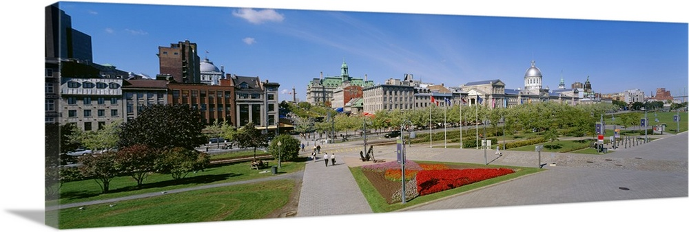 Large Solid-Faced Canvas Print Wall Art Print 48 x 16 entitled Buildings in a city, Place Jacques Cartier, Montreal, Quebe... Solid-Faced Canvas Print entitled Buildings in a city, Place Jacques Cartier, Montreal, Quebec, Canada.  Multiple sizes available.  Primary colors within this image include Dark Red, Black, Light Gray, Royal Blue.  Made in the USA.  Satisfaction guaranteed.  Inks used are latex-based and designed to last.  Featuring a proprietary design, our canvases produce the tightest corners without any bubbles, ripples, or bumps and will not warp or sag over time.  Archival inks prevent fading and preserve as much fine detail as possible with no over-saturation or color shifting.