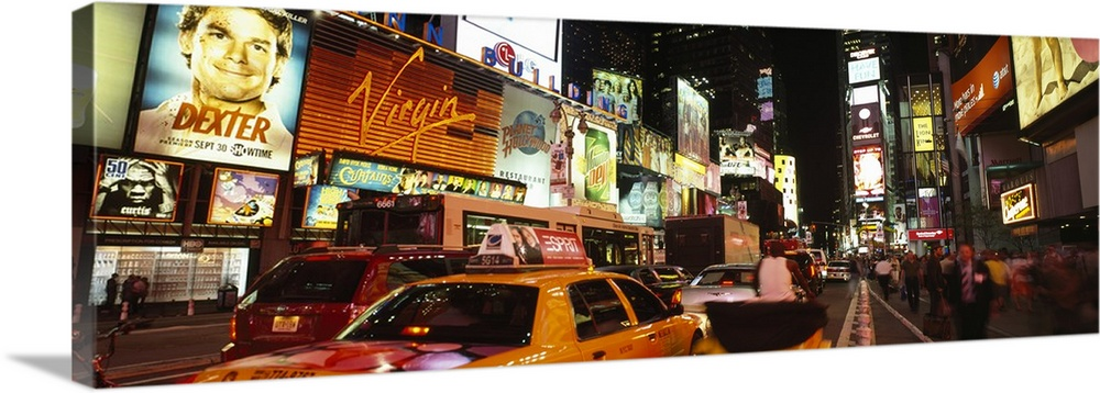 Large Solid-Faced Canvas Print Wall Art Print 48 x 16 entitled Buildings lit up at night in a city Broadway Times Square M... Solid-Faced Canvas Print entitled Buildings lit up at night in a city Broadway Times Square Midtown Manhattan Manhattan New York City New York State.  Multiple sizes available.  Primary colors within this image include Orange, Dark Red, Light Yellow, Black.  Made in USA.  Satisfaction guaranteed.  Archival-quality UV-resistant inks.  Canvas depth is 1.25 and includes a finished backing with pre-installed hanging hardware.  Archival inks prevent fading and preserve as much fine detail as possible with no over-saturation or color shifting.