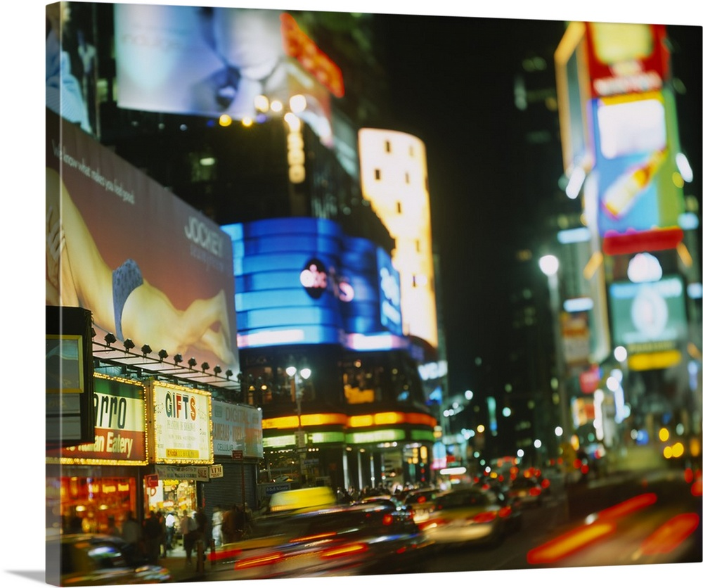 Large Solid-Faced Canvas Print Wall Art Print 30 x 24 entitled Buildings lit up at night in a city, Times Square, Manhatta... Solid-Faced Canvas Print entitled Buildings lit up at night in a city, Times Square, Manhattan, New York City, New York State.  Multiple sizes available.  Primary colors within this image include Dark Red, Dark Yellow, Dark Blue, Dark Gray.  Made in USA.  All products come with a 365 day workmanship guarantee.  Inks used are latex-based and designed to last.  Canvas depth is 1.25 and includes a finished backing with pre-installed hanging hardware.  Canvas is handcrafted and made-to-order in the United States using high quality artist-grade canvas.