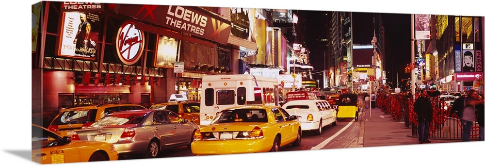Large Solid-Faced Canvas Print Wall Art Print 48 x 16 entitled Cars on the road, Times Square, Manhattan, New York City, N... Solid-Faced Canvas Print entitled Cars on the road, Times Square, Manhattan, New York City, New York State.  Panoramic photograph of many cars and taxis filling the street in Times Square, surrounded by the bright lights and billboards at night, in New York City.  Multiple sizes available.  Primary colors within this image include Orange, Dark Red, Brown, Silver.  Made in USA.  All products come with a 365 day workmanship guarantee.  Inks used are latex-based and designed to last.  Archival inks prevent fading and preserve as much fine detail as possible with no over-saturation or color shifting.  Canvas depth is 1.25 and includes a finished backing with pre-installed hanging hardware.